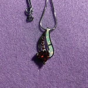Jewelry - 18 in Sterling silver chain and pendant. Garnets